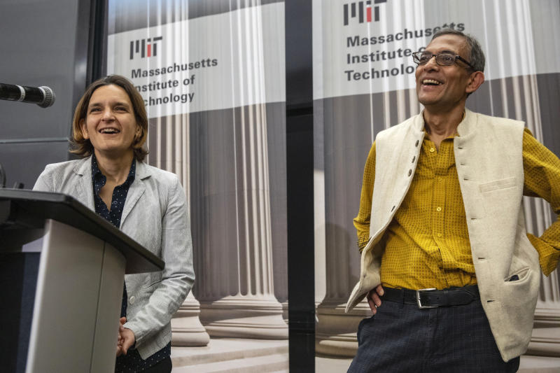 Esther Duflo, left, and Abhijit Banerjee speak during a news conference at Massachusetts Institute of Technology in Cambridge, Mass., Monday, Oct. 14, 2019. Banerjee and Duflo, along with Harvard's Michael Kremer, were awarded the 2019 Nobel Prize in economics for pioneering new ways to alleviate global poverty. (AP Photo/Michael Dwyer)