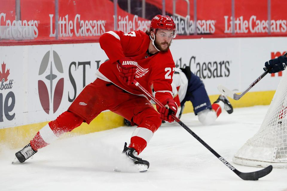 Red Wings center Michael Rasmussen skates with the puck behind the net during the second period of the 3-2 loss to the Panthers at Little Caesars Arena on Sunday, Jan. 31, 2021.