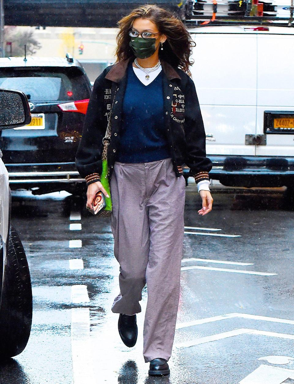 <p>Bella Hadid steps out in N.Y.C. on Thursday, wearing a black mask, lavender pants and black boots.</p>