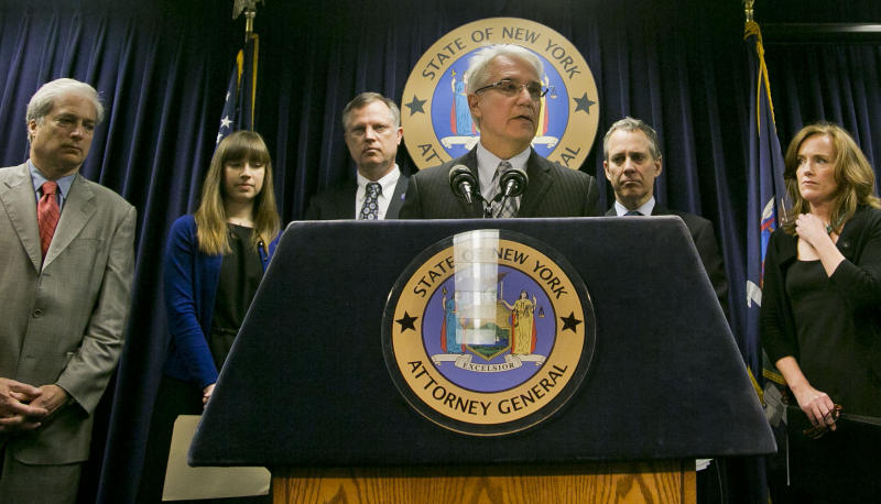 """File - In this June 13, 2013 file photo, Citizens Crime Commission of New York president Richard Aborn, far left, Annie Palazzolo, second from left, and her father Paul Boke, third from left, New York Attorney General Eric Schneiderman, second from right and Nassau County, N.Y. Distrct Attorney Kathleen Rice, far right, listens as San Francisco District Attorney George Gascon speaks about using technology to avert smartphone theft during a press conference on Thursday, June 13, 2013, in New York. Palazzolo, 29, also spoke about her sister who was killed for her cellphone. San Francisco's top prosecutor said Monday Samsung Electronics, the world's largest mobile phone manufacturer, has proposed making a """"kill switch"""" that would render stolen or lost phones inoperable a standard feature, but the nation's biggest carriers have rejected the idea. (AP Photo/Bebeto Matthews, File)"""