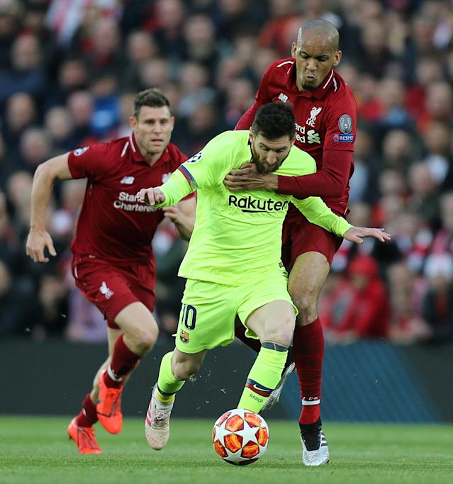 Barcelona's Lionel Messi battles with Liverpool's Fabinho during the UEFA Champions League Semi Final second leg match between Liverpool and Barcelona at Anfield on May 7, 2019 in Liverpool, England. (Photo by Rich Linley - CameraSport via Getty Images)