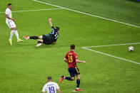France's Kylian Mbappe, left, kicks the ball past Spain's goalkeeper Unai Simon to score his team's second goal during the UEFA Nations League final soccer match between Spain and France at the San Siro stadium, in Milan, Italy, Sunday, Oct. 10, 2021. (Miguel Medina/Pool Photo via AP)