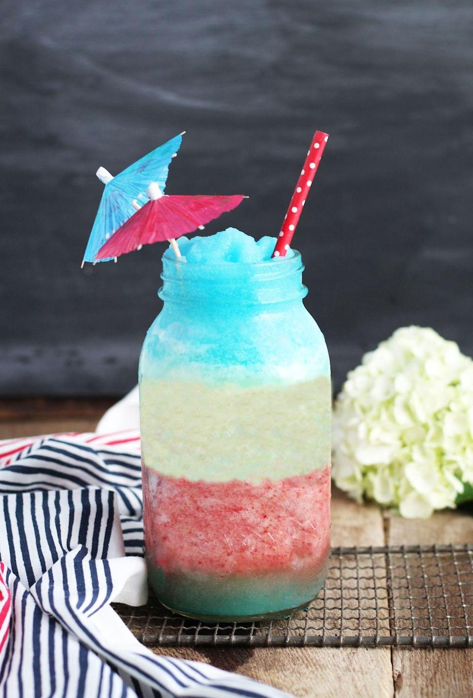 """<p>We're spiking the summer staple with frozen berries and Blue Curacao. Have one-too-many and you may just see stars. <em><br></em></p><p><a href=""""http://www.3yummytummies.com/red-white-blue-pina-colada/"""" rel=""""nofollow noopener"""" target=""""_blank"""" data-ylk=""""slk:Get the recipe from 3 Yummy Tummies »"""" class=""""link rapid-noclick-resp""""><em>Get the recipe from 3 Yummy Tummies »</em></a></p>"""