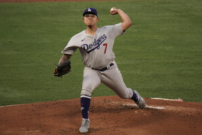 Los Angeles Dodgers starting pitcher Julio Urias throws against the Los Angeles Angels during the first inning of a baseball game, Friday, May 7, 2021, in Anaheim, Calif. (AP Photo/Jae C. Hong)