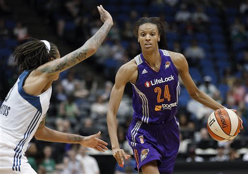 Phoenix Mercury guard DeWanna Bonner (24) drives as Minnesota Lynx guard Seimone Augustus defends during the second half of a WNBA basketball game, Thursday, June 6, 2013, in Minneapolis. The Lynx won 99-79. (AP Photo/Stacy Bengs)