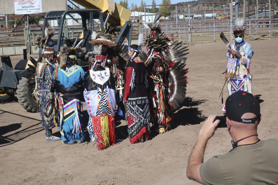 Native American dancers prepare to perform at a Donald Trump rally Oct. 15, 2020 at the rodeo grounds in Williams, Arizona. Navajo Nation President Myron Lizer makes no qualms about it: As one of the top officials on the country's largest Native American reservation, he's a proud Donald Trump supporter. (AP Photo/Felicia Fonseca)