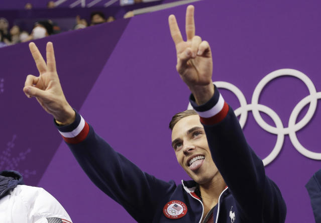 Adam Rippon of the United States reacts as his score is posted following his performance in the men's short program figure skating. (AP)