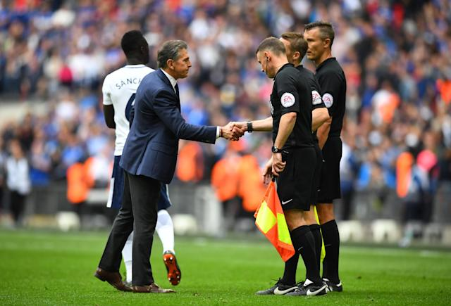 "Soccer Football - Premier League - Tottenham Hotspur vs Leicester City - Wembley Stadium, London, Britain - May 13, 2018 Leicester City manager Claude Puel shakes hands with the match officials after the match REUTERS/Dylan Martinez EDITORIAL USE ONLY. No use with unauthorized audio, video, data, fixture lists, club/league logos or ""live"" services. Online in-match use limited to 75 images, no video emulation. No use in betting, games or single club/league/player publications. Please contact your account representative for further details."