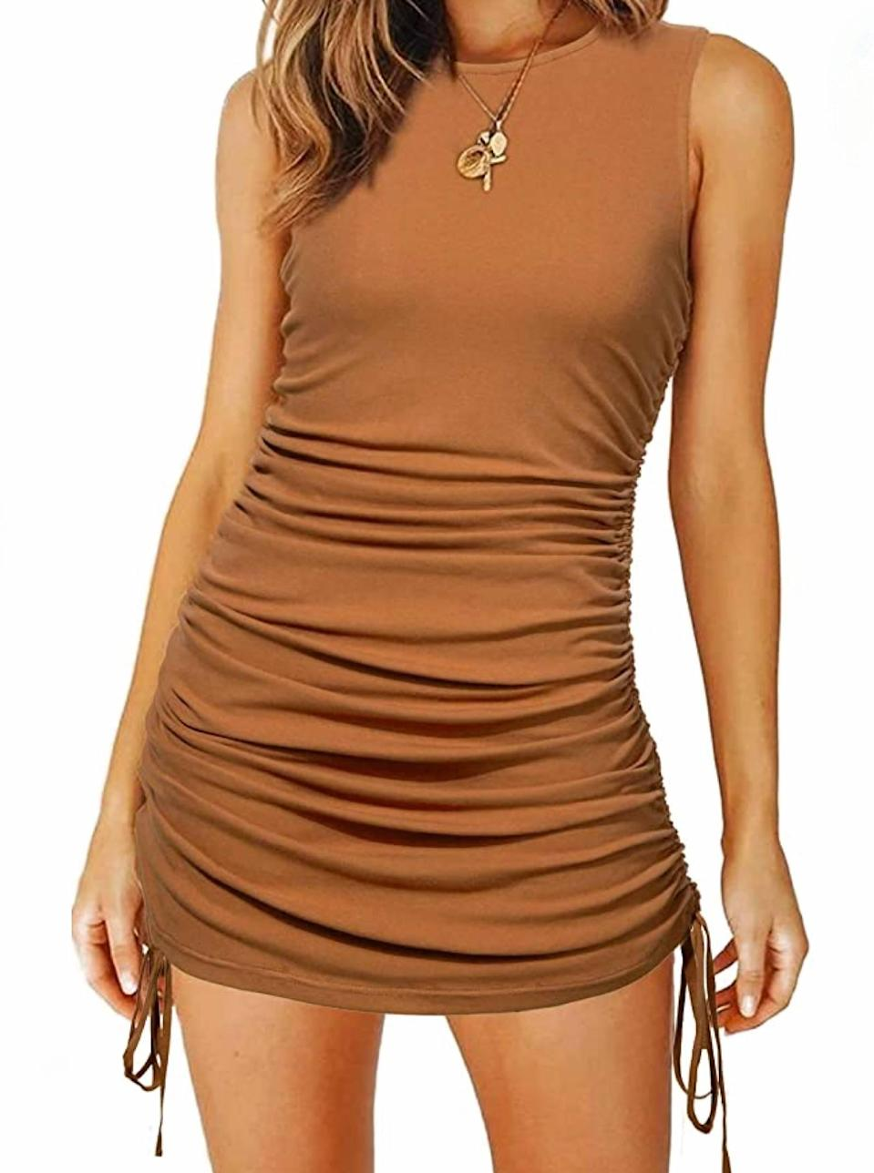 """When a heatwave strikes, reach for a naked dress such as this neutral toned mini (also available in black, green, and rust). $16, Amazon. <a href=""""https://www.amazon.com/Zalalus-Drawstring-Bodycon-Sleeveless-Sundress/dp/B08MDWRYGH"""" rel=""""nofollow noopener"""" target=""""_blank"""" data-ylk=""""slk:Get it now!"""" class=""""link rapid-noclick-resp"""">Get it now!</a>"""