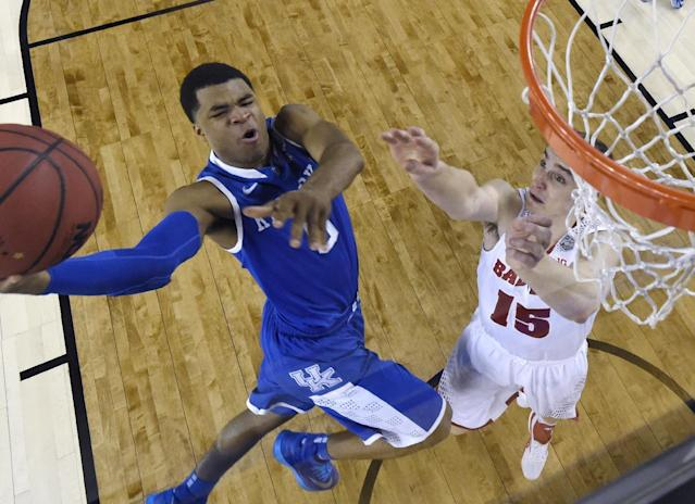 Kentucky guard Andrew Harrison (5) drives to the basket past Wisconsin forward Sam Dekker, right, during the first half of an NCAA Final Four tournament college basketball semifinal game Saturday, April 5, 2014, in Arlington, Texas. (AP Photo/Chris Steppig, pool)
