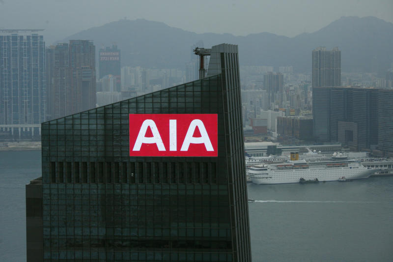 A panel on top of AIA Central, previously AIG Tower, flashes the company sign at Hong Kong's financial Central district February 12, 2010. American International Group has lined up all the major investment banks to underwrite the public listing of its Asian life insurance unit, in what may be Hong Kong's biggest IPO since 2006, banking sources said. REUTERS/Bobby Yip (CHINA - Tags: CITYSCAPE BUSINESS)