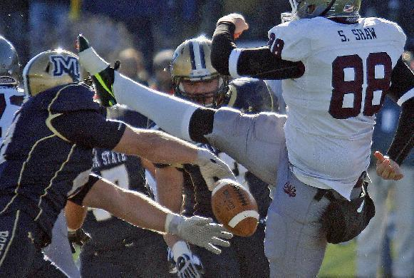 Montana punter Shephen Shaw (88) has a punt blocked by Montana State defensive end Brad Daly, left, in the first quarter of an NCAA college football game in Bozeman, Mont., Saturday, Nov. 23, 2013. (AP Photo/Michael Albans)