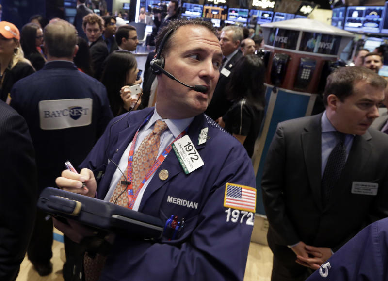 Trader Jonathan Corpina, left, works on the floor of the New York Stock Exchange, Friday, April 12, 2013. The stock market is heading lower in early trading after a four-day rise as bank shares weaken. (AP Photo/Richard Drew)