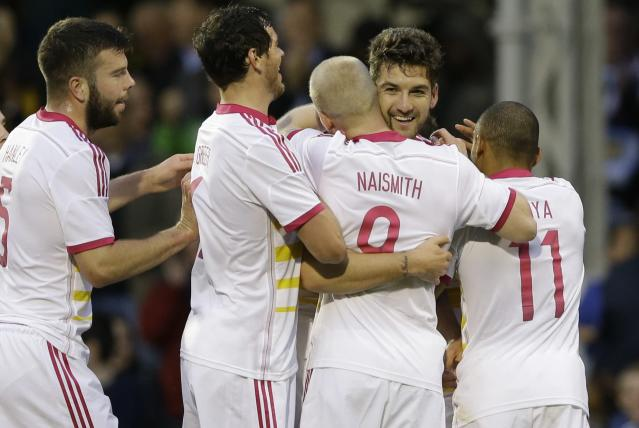Scotland's Charlie Mulgrew, second right, celebrates after scoring a goal during the international friendly soccer match between Nigeria and Scotland at Craven Cottage Stadium in London, Wednesday, May 28, 2014. Nigeria will be in Group F in the upcoming World Cup in Brazil (AP Photo/Kirsty Wigglesworth)