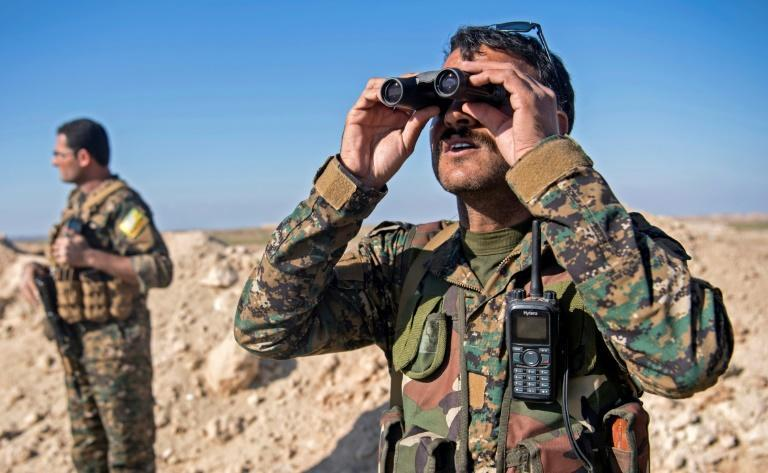 The SDF have built up a pair of sand embankments on a scrubby plateau overlooking Baghouz