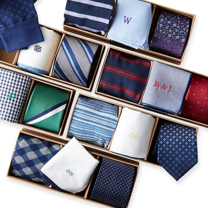 """<p><strong>The Tie Bar x Mark & Graham</strong></p><p>Mark & Graham</p><p><strong>$55.00</strong></p><p><a href=""""https://go.redirectingat.com?id=74968X1596630&url=https%3A%2F%2Fwww.markandgraham.com%2Fproducts%2Fsock-hankie-and-tie-set%2F&sref=https%3A%2F%2Fwww.countryliving.com%2Fshopping%2Fgifts%2Fg34500004%2Fmonogram-gift-ideas%2F"""" rel=""""nofollow noopener"""" target=""""_blank"""" data-ylk=""""slk:Shop Now"""" class=""""link rapid-noclick-resp"""">Shop Now</a></p><p>Getting ready has never been easier when he has this suit accessory set that includes a pair of cotton blend socks, a 100% cotton monogrammed handkerchief/pocket square, and a silk tie.</p>"""