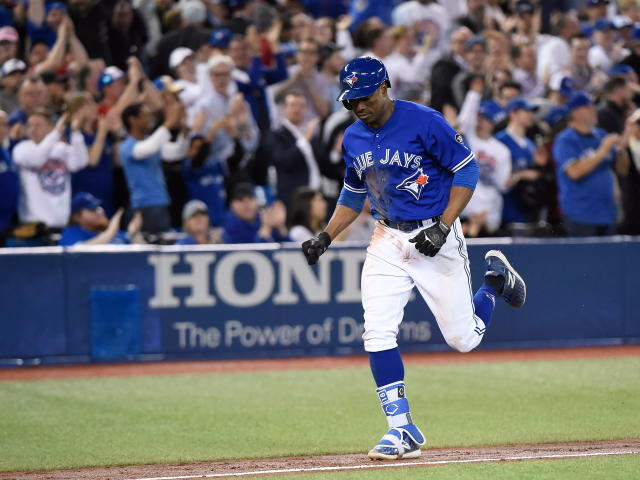 Toronto Blue Jays' Curtis Granderson rounds the bases after hitting a grand slam off Kansas City Royals relief pitcher Justin Grimm during the eighth inning of a baseball game Wednesday, April 18, 2018, in Toronto. (Nathan Denette/The Canadian Press via AP)