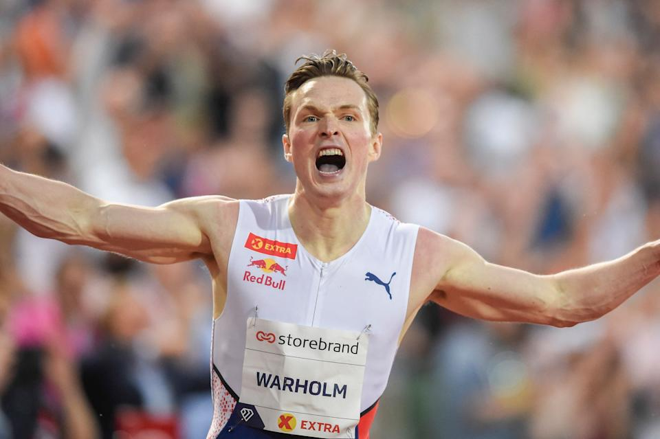 Norway's Karsten Warholm reacts after winning and breaking the world record during the 400m hurdles men final at the Diamond League track and field meeting in Oslo on July 1, 2021. - Norway's Karsten Warholm fired out a shot at potential Tokyo Olympic rivals when he shattered the long-standing 400m hurdles world record at Diamond League meet in Oslo and warned he had