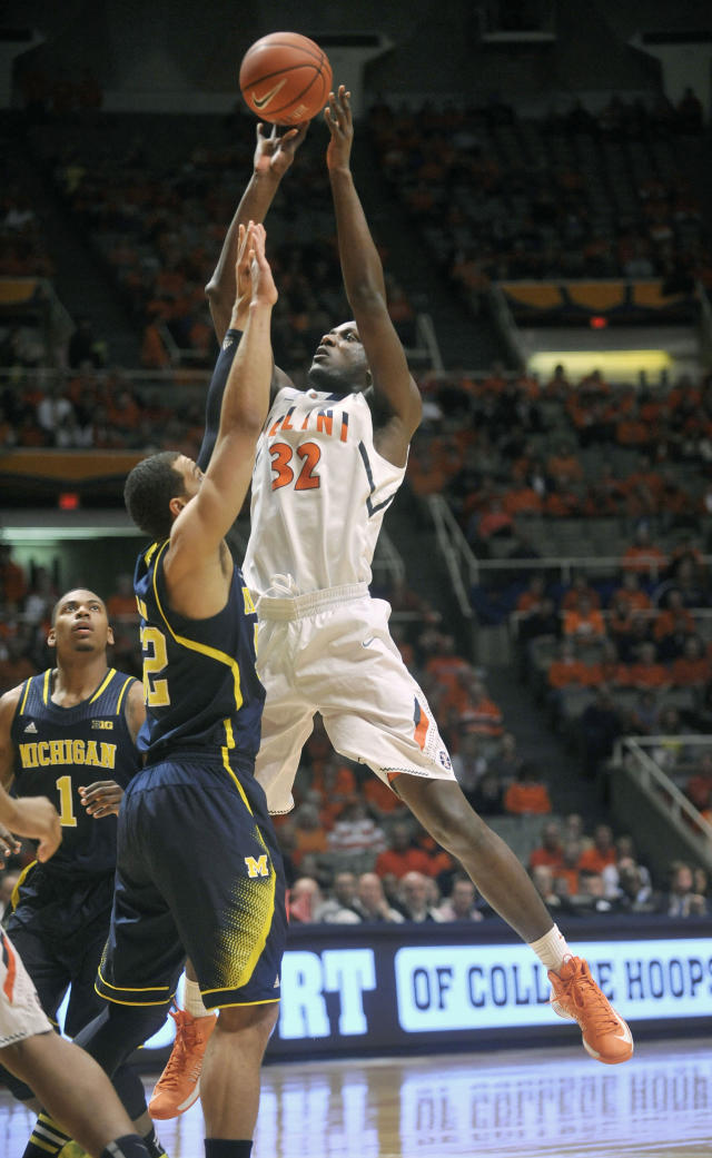 Illinois' Nnanna Egwu (32) shoots over Michigan forward Jordan Morgan (52) during the first half of an NCAA college basketball game Tuesday, March 4, 2014, in Champaign, Ill. (AP Photo/Rick Danzl)