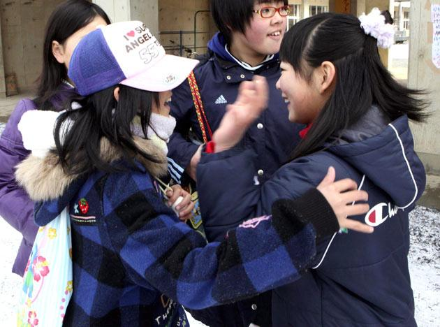 Students react as they were reunited at an elementary school in Ofunato, northern Japan Thursday, March 17, 2011 following Friday's massive earthquake and tsunami. (AP Photo/Yomiuri Shimbun, Masamichi Genko)
