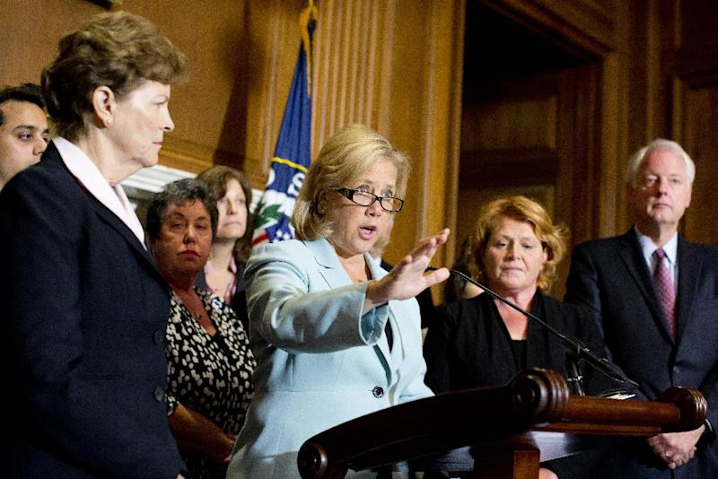 "FILE - In this Oct. 3, 2013, file photo Sen. Mary Landrieu, D-La., center, with Sen. Jeanne Shaheen, D-N.H., left, Sen. Heidi Heitkamp, D-N.D., right, and others, speaks at a news conference and Capitol Hill in Washington with small business owners about the impact the government shutdown is having on business. With the shutdown continuing and the nation's credit rating under threat, Landrieu stands out among Southern Democratic candidates with her embrace of the three-year-old health care law at the core of Capitol Hill dysfunction. She called Republicans ""reckless and irresponsible and radical"" for using the federal budget and looming vote to raise the debt ceiling as leverage for demands to scrap health care reform. (AP Photo/ Evan Vucci, File)"