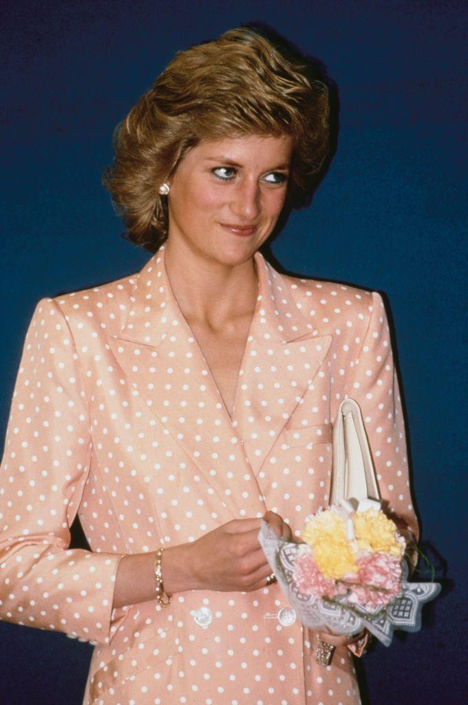 <p>A return to Diana's forever favorite pattern: polka dots. She wore this peach polka dot blazer in July 1989.<br></p>