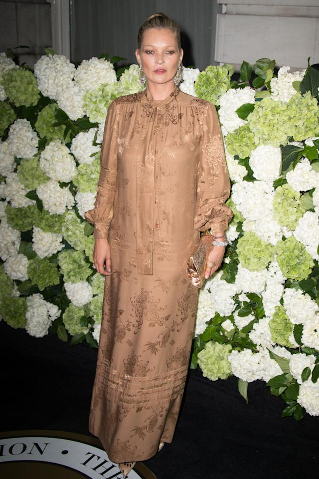 <p>Kate Moss looks wonderful in chic full length dresses like this gold, silk version. More, please! <i>[Photo: PA]</i></p>