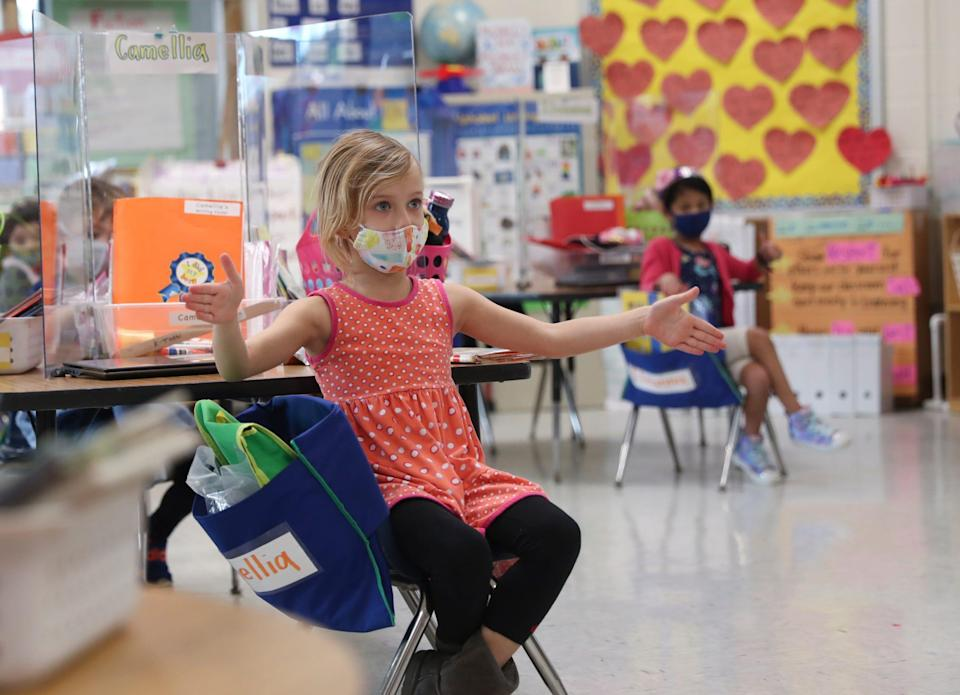 Kindergarten students wear masks and are socially distanced during in-school class at Concord Road Elementary School in Ardsley, New York, on Tuesday, December 1, 2020.
