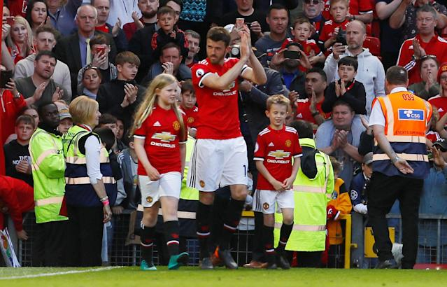 "Soccer Football - Premier League - Manchester United vs Watford - Old Trafford, Manchester, Britain - May 13, 2018 Manchester United's Michael Carrick walks on to the pitch to applaud the fans with his children after the match Action Images via Reuters/Jason Cairnduff EDITORIAL USE ONLY. No use with unauthorized audio, video, data, fixture lists, club/league logos or ""live"" services. Online in-match use limited to 75 images, no video emulation. No use in betting, games or single club/league/player publications. Please contact your account representative for further details."