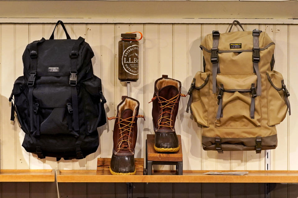 Backpacks and Bean Boots are displayed at the L.L. Bean flagship retail store, Thursday, March 18, 2021, in Freeport, Maine. Maine-based retailer L.L. Bean saw the best sales in nearly a decade during pandemic. Officials say the Freeport-based retailer started its fiscal year with store closings and worries about survival but the company weathered the turbulent times to revenue growth of 5%. (AP Photo/Robert F. Bukaty)