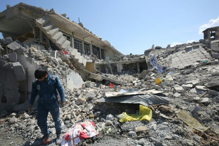 The rubble of a building in Mosul al-Jadidah, after the area was pounded by air strikes