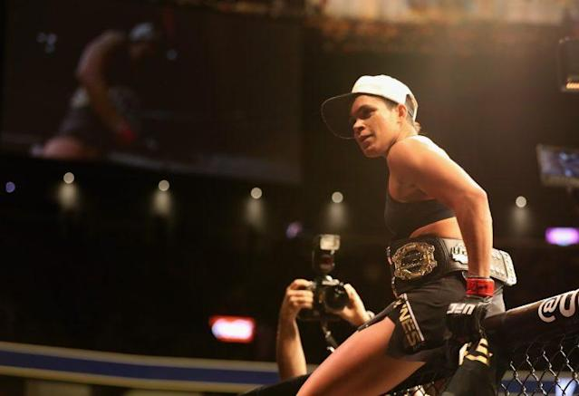Amanda Nunes reacts to her victory over Ronda Rousey during UFC 207 on Dec. 30, 2016. (Getty Images)