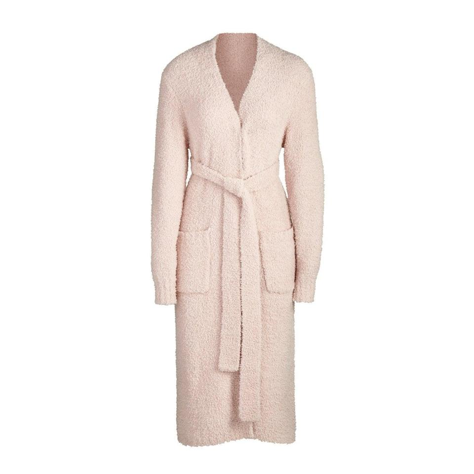 """<h2>Skims Cozy Knit Robe</h2><br>""""I've never been a robe person — I don't think I've ever even owned one. But as the months get colder and I'm spending my days WFH until next summer, I decided it was time to get a good soft one. I fell into the trap of Kim K's Instagram ads for this cozy robe and ended up pulling the trigger on the light pink dusk color with the matching joggers the day they launched. As soon as I opened up the package, I knew I'd made the right choice. It's SO soft."""" – <a href=""""https://www.instagram.com/lizzygulino/?hl=en"""" rel=""""nofollow noopener"""" target=""""_blank"""" data-ylk=""""slk:Lizzy Gulino"""" class=""""link rapid-noclick-resp""""><em>Lizzy Gulino</em></a><em>, Health & Wellness Writer</em><br><br><em>Join the <strong><a href=""""https://skims.com/products/cozy-knit-robe-dusk"""" rel=""""nofollow noopener"""" target=""""_blank"""" data-ylk=""""slk:Skims"""" class=""""link rapid-noclick-resp"""">Skims</a></strong></em> <strong><em><a href=""""https://skims.com/products/cozy-knit-robe-dusk"""" rel=""""nofollow noopener"""" target=""""_blank"""" data-ylk=""""slk:Waitlist"""" class=""""link rapid-noclick-resp"""">Waitlist</a></em></strong><br><br><strong>Skims</strong> Skims Cozy Knit Robe, $, available at <a href=""""https://go.skimresources.com/?id=30283X879131&url=https%3A%2F%2Fskims.com%2Fproducts%2Fcozy-knit-robe-dusk"""" rel=""""nofollow noopener"""" target=""""_blank"""" data-ylk=""""slk:Skims"""" class=""""link rapid-noclick-resp"""">Skims</a>"""