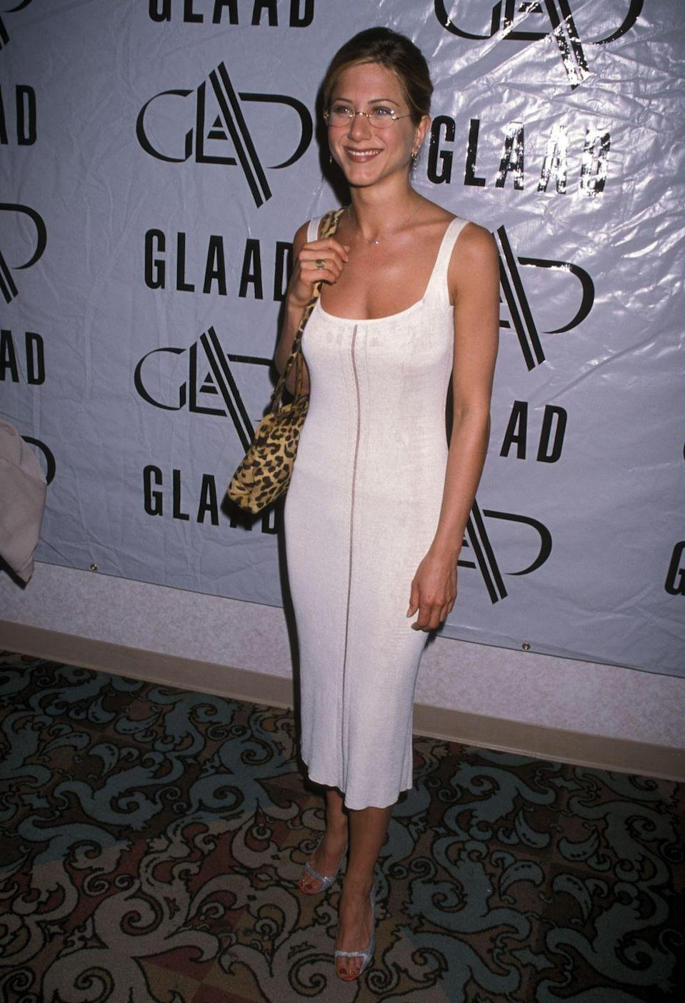 <p>Jen rocked this white midi to the 9th Annual GLAAD Media Awards in 1998. She totally rocks it.<br></p>