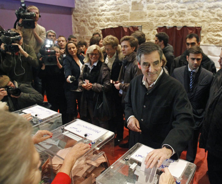 Former French prime minister Francois Fillon and candidate to head the conservative UMP party, cast his vote at a polling station in Paris, Sunday Nov. 18, 2012. France's conservative UMP party votes Sunday to pick a new leader in an internal election that members hope will mark a turning point after a string of painful defeats that have left it in the opposition. (AP Photo/Remy de la Mauviniere)