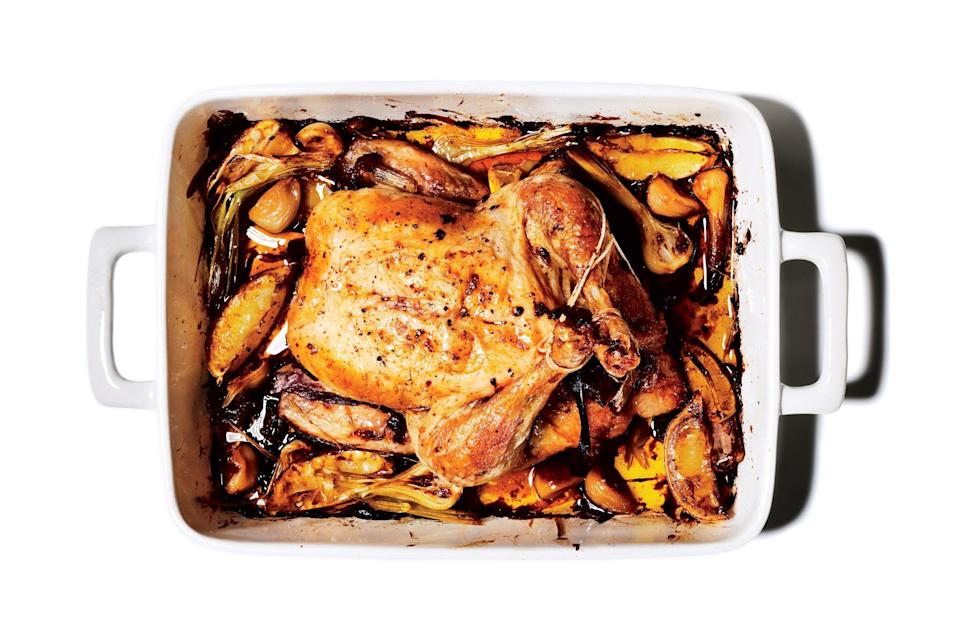 """Chicken is a classic pick for Passover dinner, but this one is exceptional, since it features fresh green garlic, which is just starting to pop up at markets this time of year. <a href=""""https://www.epicurious.com/recipes/food/views/slow-roasted-chicken-with-all-the-garlic?mbid=synd_yahoo_rss"""" rel=""""nofollow noopener"""" target=""""_blank"""" data-ylk=""""slk:See recipe."""" class=""""link rapid-noclick-resp"""">See recipe.</a>"""