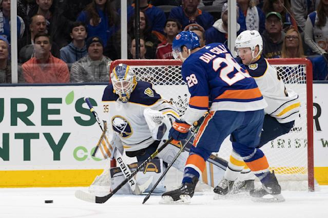 New York Islanders left wing Michael Dal Colle (28) attempts a shot against Buffalo Sabres goaltender Linus Ullmark (35) during an NHL hockey game, Saturday, Dec. 14, 2019 in Uniondale, N.Y. (AP Photo/Mark Lennihan)