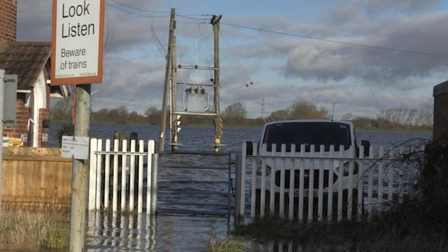 A powerline underwater in Snaith, East Yorkshire, where locals have criticised the lack of help they have received from the authorities (PA)
