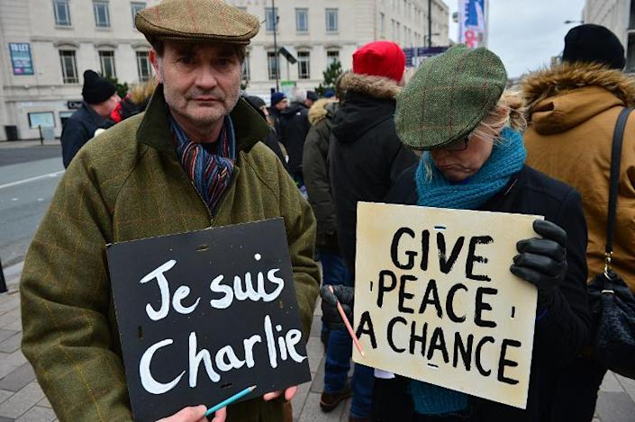 Participants join march in Liverpool on January 11, 2015 to show solidarity with those gathered in Paris after the Islamist attacks in France (AFP Photo/Paul Ellis)