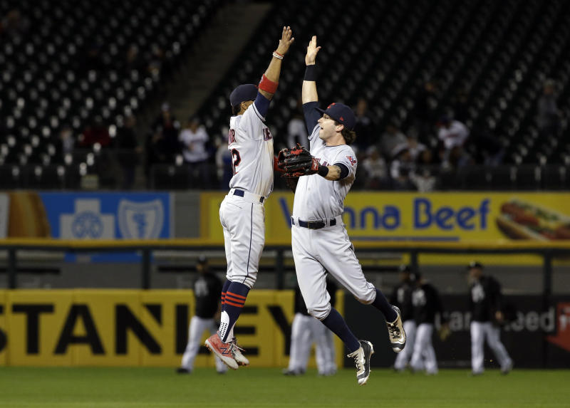 Francisco Lindor, left, celebrates with Tyler Naquin after the Indians won their 15th straight game. (AP)