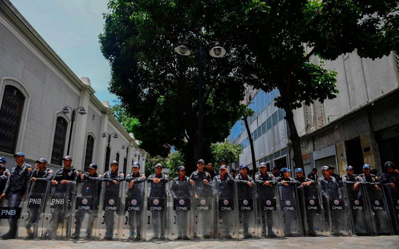 Members of Venezuela's Bolivarian National Police stand guard in the surroundings of the Federal Legislative Palace, which houses both the opposition-led National Assembly and the pro-government National Constituent Assembly, in Caracas  - AFP
