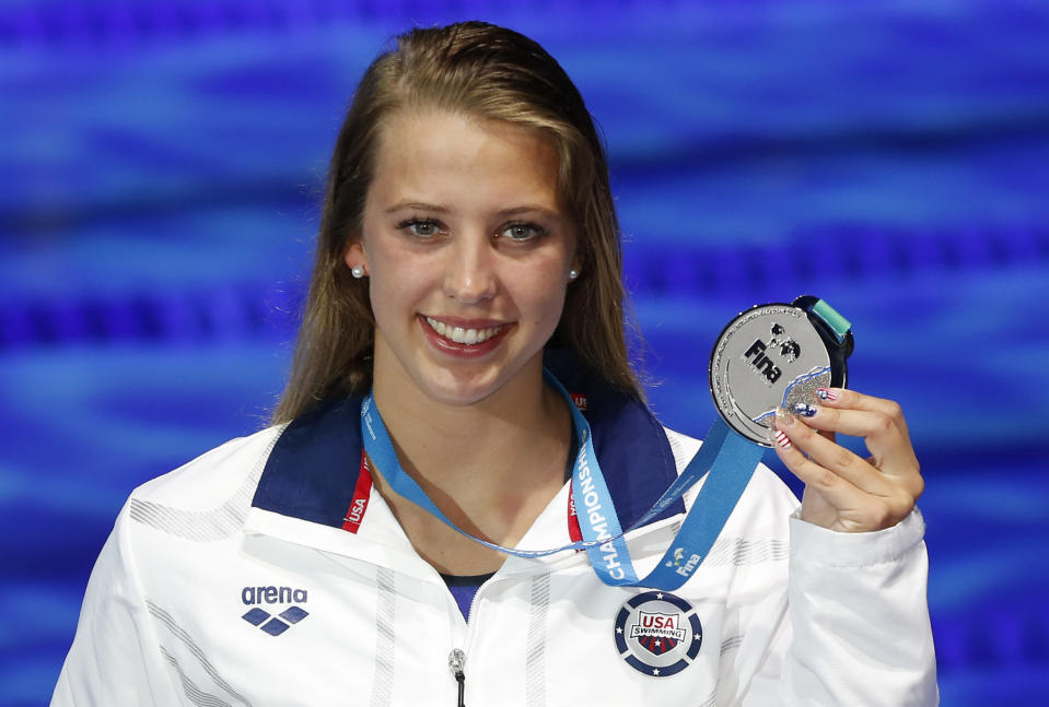 United States' silver medal winner Kathleen Baker shows off her medal after the women's 100-meter backstroke final during the swimming competitions of the World Aquatics Championships in Budapest, Hungary, Tuesday, July 25, 2017.(AP Photo/Darko Bandic)