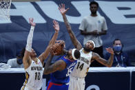 LA Clippers center DeMarcus Cousins (15) is stopped as he goes to the basket against New Orleans Pelicans center Jaxson Hayes (10) and forward Brandon Ingram (14) in the second half of an NBA basketball game in New Orleans, Monday, April 26, 2021. The Pelicans won 120-103. (AP Photo/Gerald Herbert)