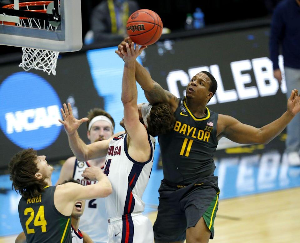 Baylor guard Mark Vital, right, blocks a shot by Gonzaga's Corey Kispert during the men's 2021 NCAA Tournament championship game April 5 in Indianapolis.
