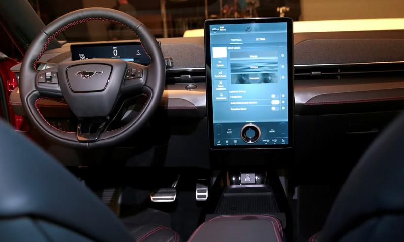 "Ford Motor Co's next generation SYNC 4 communications and entertainment system on a 15.5"" touchscreen display screen is seen in the interior of Ford's all-new electric Mustang Mach-E vehicle at a studio in Warren, Michigan"