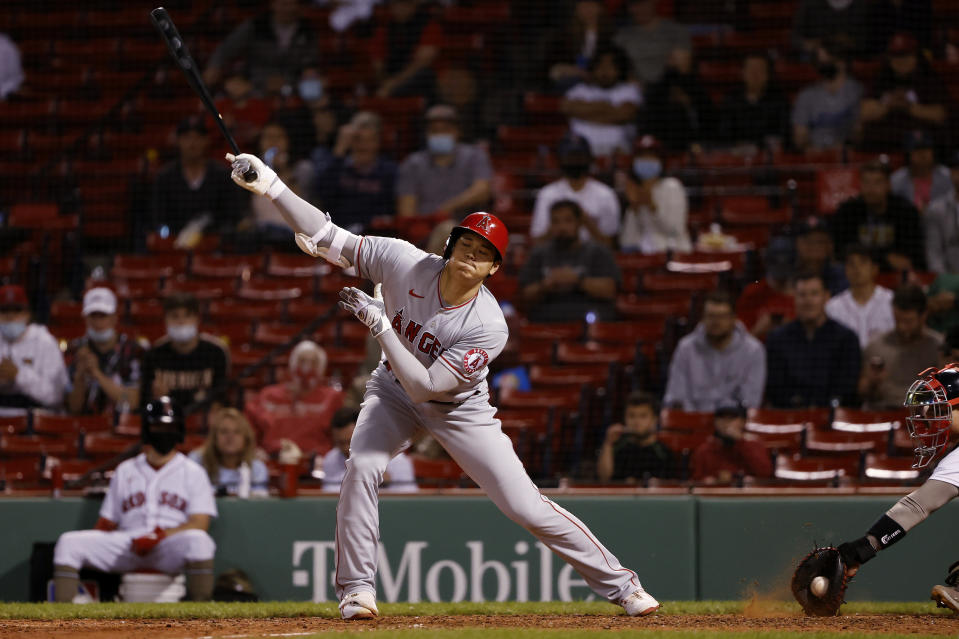 Los Angeles Angels' Shohei Ohtani strikes out swinging during the eighth inning of the team's baseball game against the Boston Red Sox on Friday, May 14, 2021, at Fenway Park in Boston. (AP Photo/Winslow Townson)