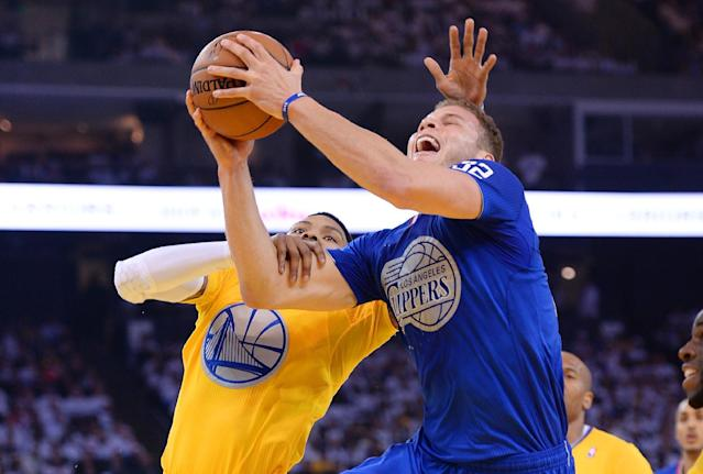 OAKLAND, CA - DECEMBER 25: Blake Griffin #32 of the Los Angeles Clippers gets fouled by Kent Bazemore #20 of the Golden State Warriors during the first quarter at ORACLE Arena on December 25, 2013 in Oakland, California. (Photo by Thearon W. Henderson/Getty Images)