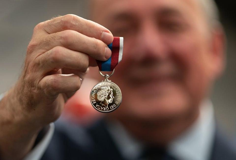 Worcestershire Medal Service chief executive Phil McDermott with the Queen's Platinum Jubilee Medal. Joe Giddens/PA Wire (PA)