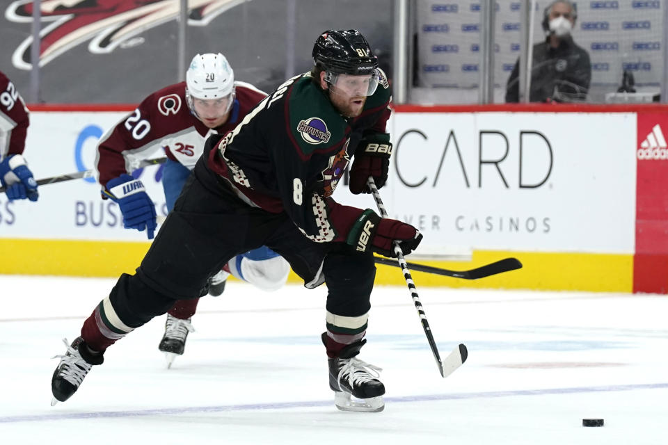 Arizona Coyotes right wing Phil Kessel (81) skates away from Colorado Avalanche left wing Brandon Saad during the third period of an NHL hockey game Tuesday, March 23, 2021, in Glendale, Ariz. Arizona won 5-4 in a shootout. (AP Photo/Rick Scuteri)