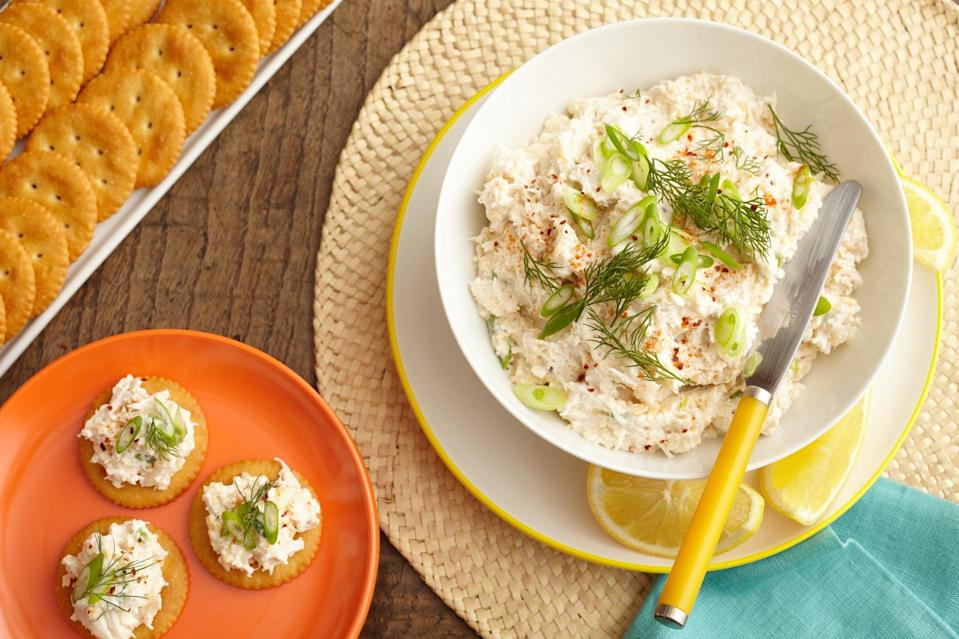 """<p>This cheesy, creamy crab spread topped on a cracker will pique the interest of any seafood lover. Bursting with flavor and packed with tasty ingredients, even the most bite-size servings are guaranteed to satisfy.</p> <p><strong>Get the recipe: </strong><a href=""""https://www.popsugar.com/food/Cheesy-Crab-Spread-43463885"""" class=""""link rapid-noclick-resp"""" rel=""""nofollow noopener"""" target=""""_blank"""" data-ylk=""""slk:cheesy crab spread"""">cheesy crab spread</a></p>"""
